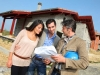Entrepreneur showing house under construction to couple